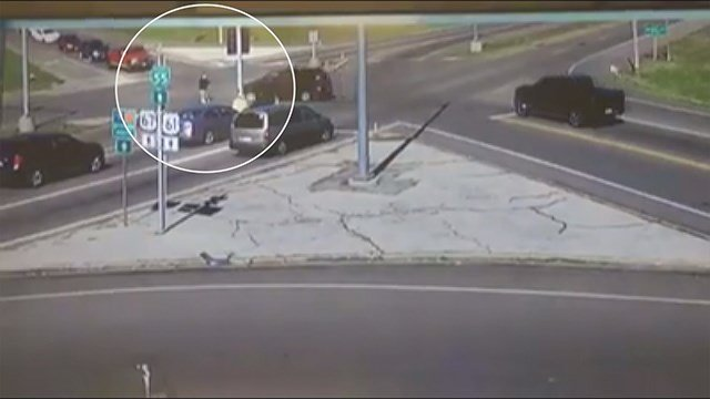 Video from a nearby business captured the exact moment a pedestrian was struck. (Credit: KMOV).