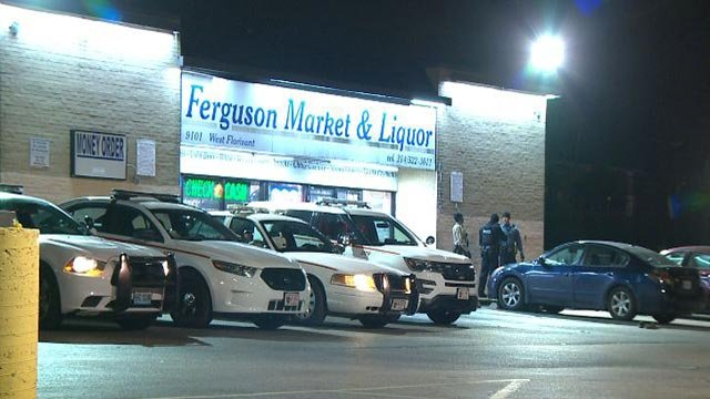 Officers outside Ferguson Market early Monday morning (Credit: KMOV)