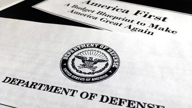 (AP Photo/Jon Elswick). A portion of President Donald Trump's first proposed budget, focusing on the Department of Defense, and released by the Office of Management and Budget, is photographed in Washington, Wednesday, March 15, 2017.