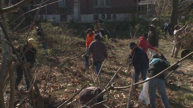 Clean up crews in north St. Louis (Credit: KMOV)