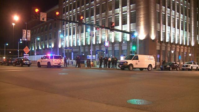 Investigators outside the MetroLink platform at Stadium and 8th Street Sunday night (Credit: KMOV)