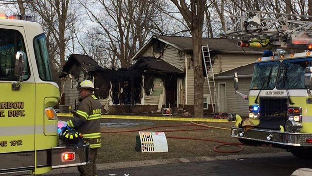 Firefighters on the scene on a fatal house fire in Glen Carbon on March 16 (Credit: Paige Hulsey / KMOV)