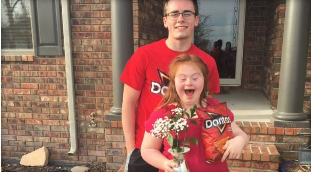 "Shaedon Wedel, 18, and Carlie Wittman, 15, pose for a picture after Wedel surprised Wittman with a ""promposal"" on March 17.  TWITTER/@SHARDONWEDEL"