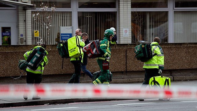 Emergency service workers arrive on the scene close to the Houses of Parliament in London, Wednesday, March 22, 2017. The leader of Britain's House of Commons says a man has been shot by police at Parliament. (AP Photo/Matt Dunham)