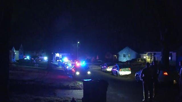 Officers outside a home in Glasgow Village following an apparent murder-suicide Monday (Credit: KMOV)