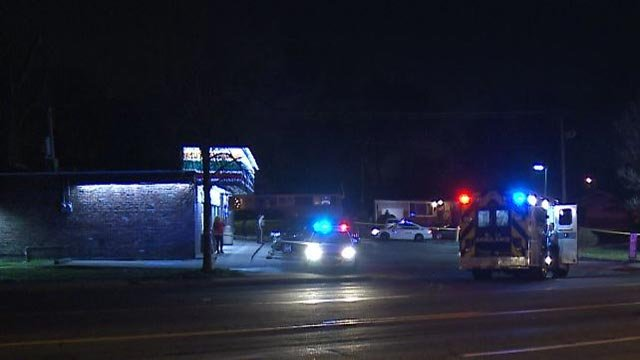 Emergency crews at the 7-Eleven on Chambers after a man was found shot (Credit: KMOV)