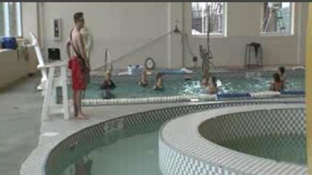 A lifeguard watching over a pool (Credit: KMOV)