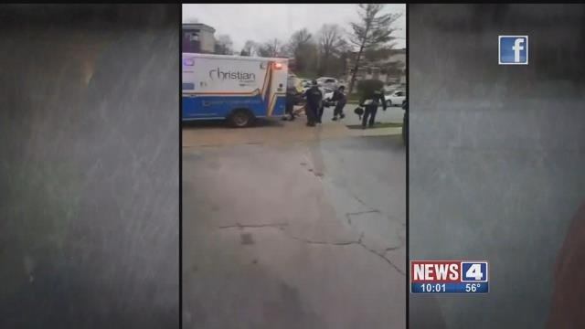 Paramedics and police put a man in an ambulance after he was shot by a security guard in Ferguson Tuesday. Credit: KMOV