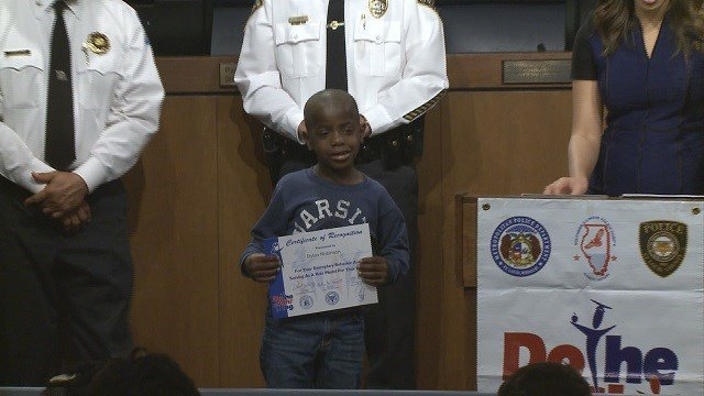 A Dewey Elementary student was honored for his bravery for noticing a house on fire through his classroom window. (Credit: KMOV)