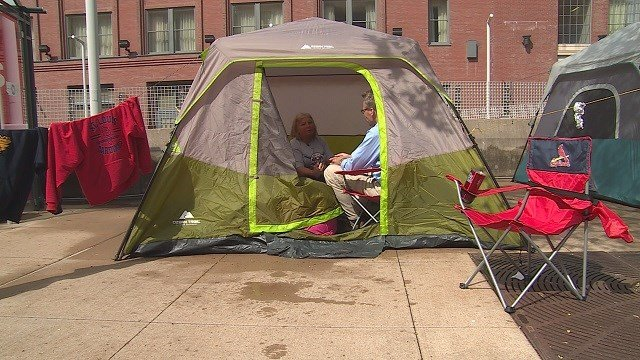 Fans are camping on the sidewalk outside of Busch to get their hands on a Opening Day offer. (Credit: KMOV)