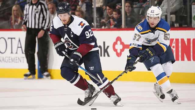 David Perron #57 of the St. Louis Blues defends against Gabriel Landeskog #92 of the Colorado Avalanche at the Pepsi Center on March 31, 2017 in Denver, Colorado. (Photo by Michael Martin/NHLI via Getty Images)
