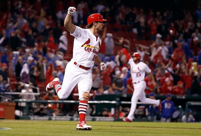 St. Louis Cardinals' Randal Grichuk, left, celebrates after hitting a walk-off single as Jose Martinez, right, comes in to score the winning run to defeat the Chicago Cubs, 4-3. (AP Photo/Jeff Roberson)