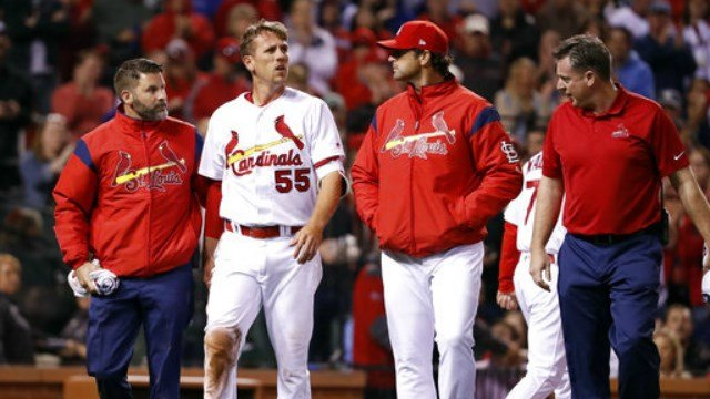 St. Louis Cardinals' Stephen Piscotty (55) walks off the field after being injured while scoring during the fifth inning of a baseball game against the Chicago Cubs Tuesday, April 4, 2017, in St. Louis. (AP Photo/Jeff Roberson)