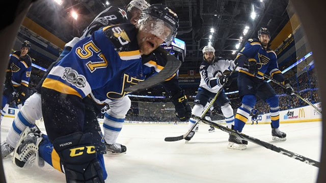 David Perron #57 of the St. Louis Blues attempts to regain control of the puck after being pushed to the ice by Jacob Trouba #8 of the Winnipeg Jets on April 4, 2017 at Scottrade Center in St. Louis, Missouri. (Photo by Scott Rovak/NHLI via Getty Images)