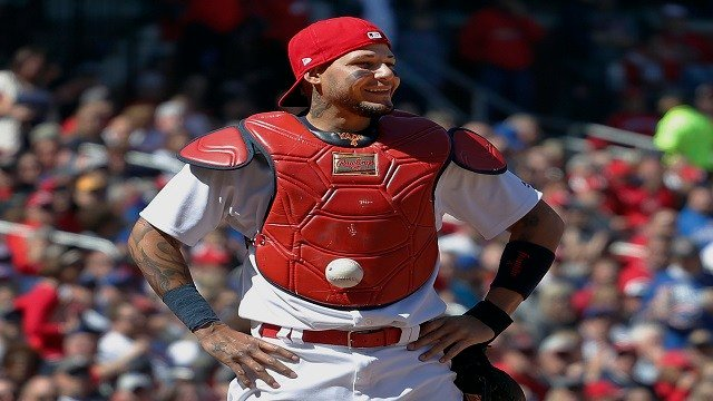 Yadier Molina stands with his hands on his hips as a ball is somehow stuck to his chest protector during the seventh inning of a baseball game against the Chicago Cubs on Thursday, April 6, 2017, in St. Louis. (AP Photo/Jeff Roberson)