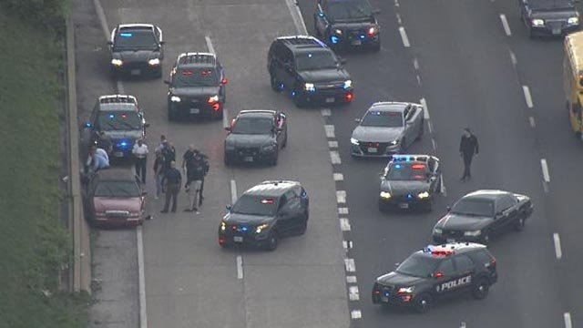 Numerous police vehicles on I-70 after the police chase ended in St. Louis County (Credit: KMOV)