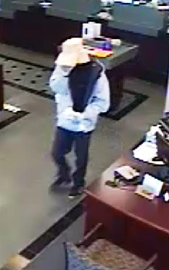 Surveillance photo of suspect (Credit: St. Louis County Police)
