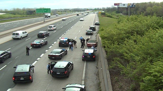 Officers take suspect in custody on I-70 near Lambert Airport Monday morning (Ray Preston, KMOV)