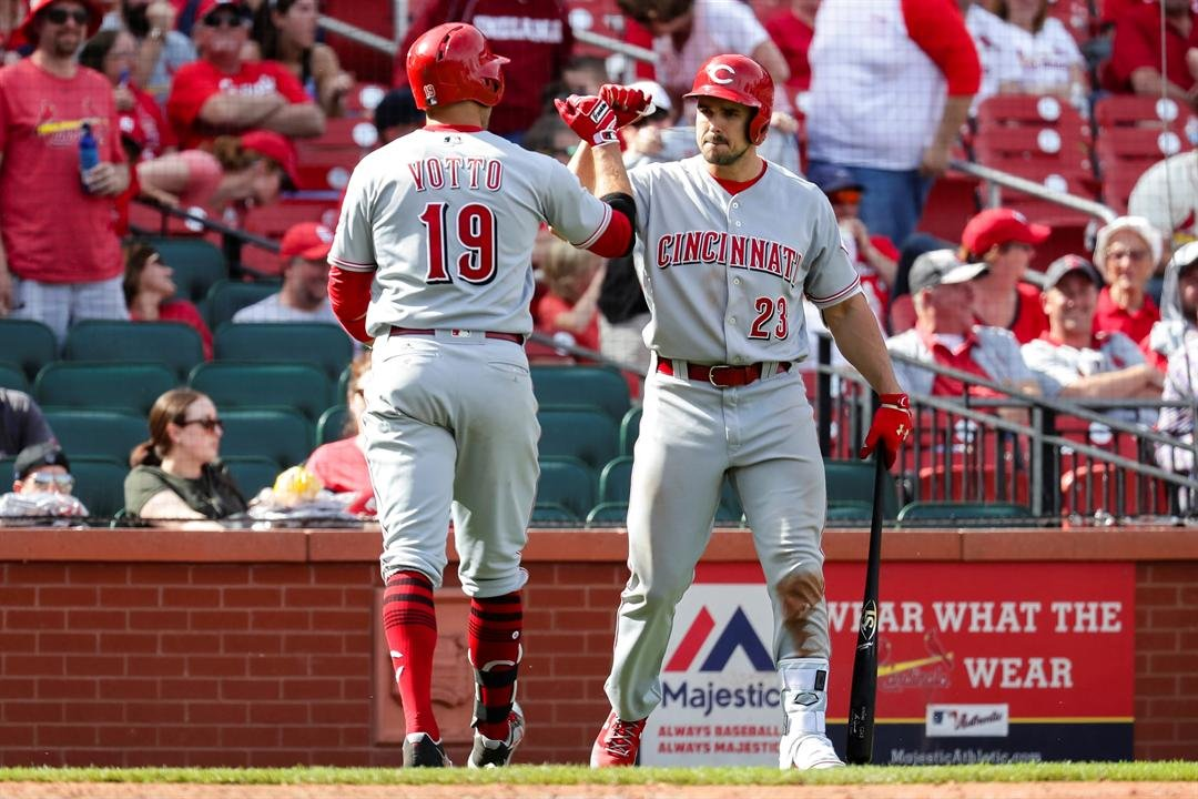Cincinnati Reds' Joey Votto (19) is congratulated by Adam Duvall (23) after hitting a solo home run during the ninth inning of a baseball game against the St. Louis Cardinals Sunday, April 9, 2017, in St. Louis. (AP Photos)