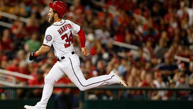 Bryce Harper #34 of the Washington Nationals runs safe to third base against the St. Louis Cardinals in the third inning at Nationals Park on April 10, 2017 in Washington, DC. (Photo by Matt Hazlett/Getty Images)