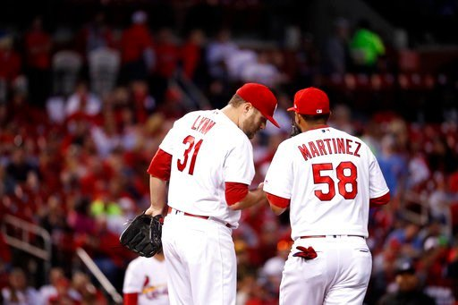 St. Louis Cardinals first baseman Jose Martinez (58) talks with starting pitcher Lance Lynn during the seventh inning of a baseball game against the Pittsburgh Pirates Monday, April 17, 2017, in St. Louis. (AP Photo/Jeff Roberson)