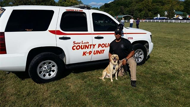 Ben and his handler Officer Derrick Fort Sr. (Credit: St. Louis County Police Department)