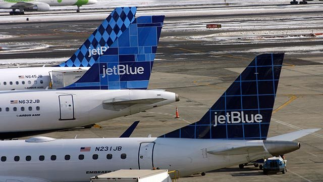 JetBlue planes (Credit: AP / Rick Maiman, File)