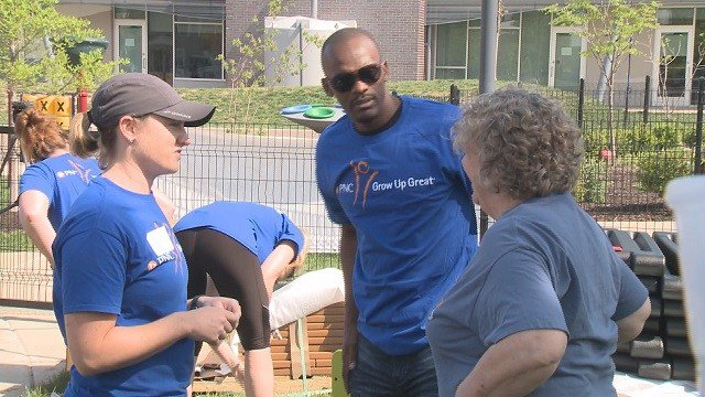 Isaac Bruce was in town Tuesday to build a playground in north St. Louis. (Credit: KMOV)