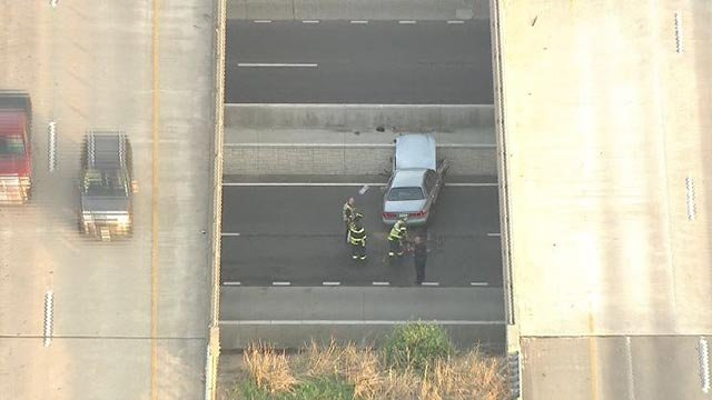 A woman was injured when the car traveled from the interstate to the Fifth Street in St. Charles Wednesday (Credit: KMOV)
