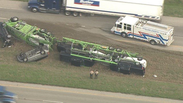 A truck used to haul cars overturned on Interstate 70 near Highland, Illinois Wednesday morning.  (KMOV)