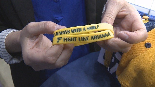 """The Blues are hopeful fans will buy """"Fight Like Arianna and Aways with a Smile"""" bracelets. (Credit: KMOV)"""