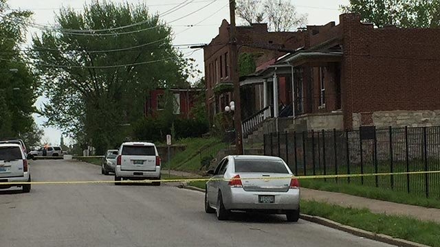 Crime scene tape in the 4600 block of Cottage after a man was shot Thursday (Credit: KMOV)