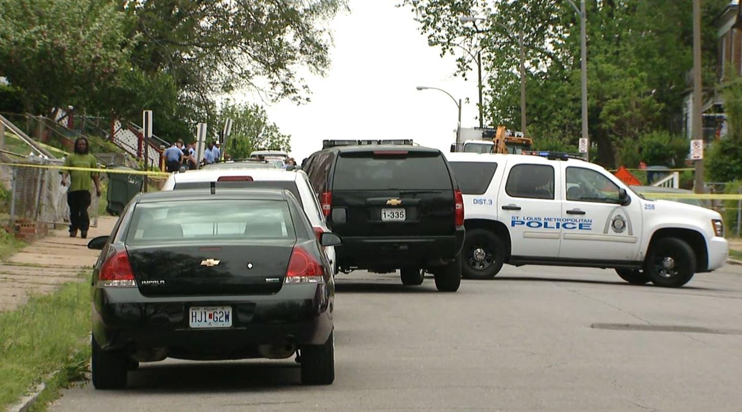 Police in the 5900 block of Minerva after 3 men were shot Thursday (Credit: KMOV)