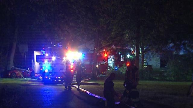 Firefighters at a blaze on Fee Fee Drive in Hazelwood (Credit: KMOV)