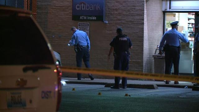 Police outside the 7-Eleven on Bates following a double shooting Monday morning (Credit: KMOV)