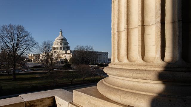 The morning sun illuminates the Capitol in Washington as Congress returns from a district work week, Monday, March 24, 2014. (Credit: AP Photo / J. Scott Applewhite)