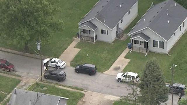 Investigators in the 4500 block of Ravenwood following a triple fatal shooting Wednesday (Credit: KMOV)