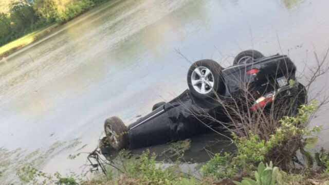 The man's car was flipped upside down in the fish hatchery in Carlyle, Ill. (Credit: Tucker Johnson)