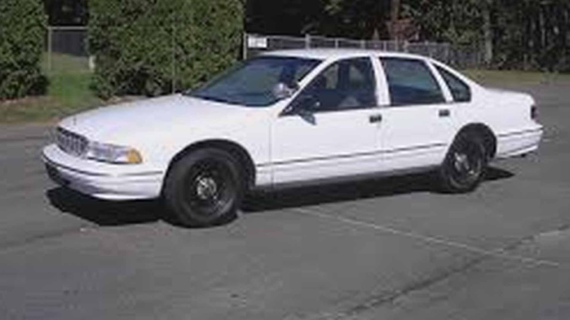 Police are looking for a car similar to this old white Chevrolet Caprice with a spot lamp on the driver's side. Credit: Major Case Squad