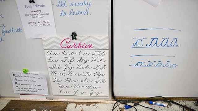 In this Wednesday, March 1, 2017, photo, a sample of cursive letters are on display in the third-grade classroom at P.S. 166 in the Queens borough of New York.  (Credit: AP Photo / Mary Altaffer)