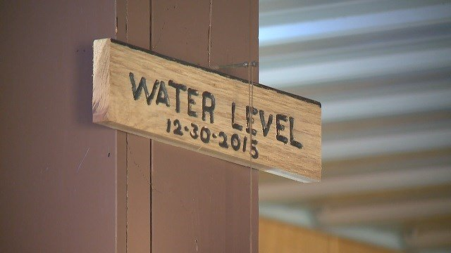 There is a plaque by the bar that shows just how high water got. (Credit: KMOV)