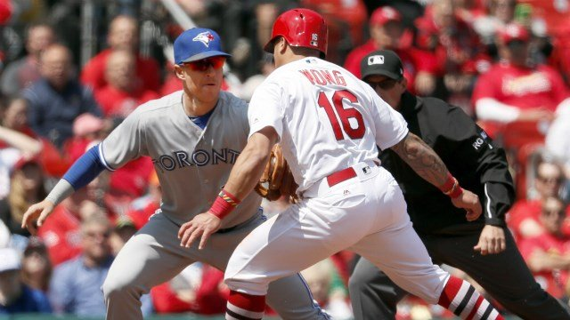 St. Louis Cardinals' Kolten Wong (16) is tagged out by Toronto Blue Jays third baseman Chris Coghlan after being picked off during the fifth inning in the first game of a baseball doubleheader Thursday, April 27, 2017, in St. Louis. (AP Photo/Jeff Roberso