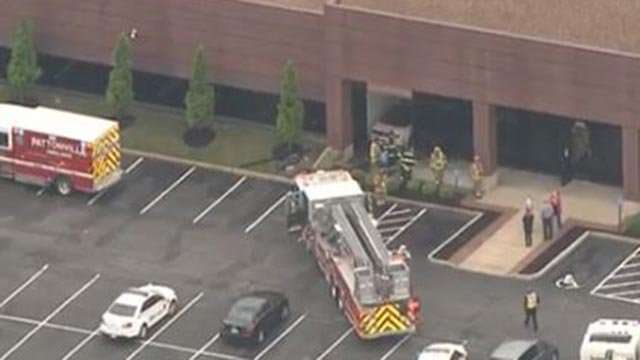 Firefighters in the 3790 block of Corporate Center Drive after a car crashed into it Friday (Credit: KMOV)