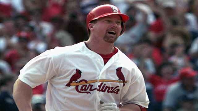 Mark McGwire rounds the bases following his 70th home run of the season on September 27, 1998 (Credit: AP)