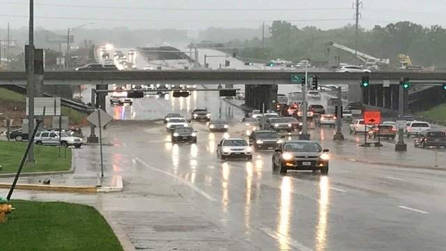 Police close one lane of Route 141 due to rising waters. (Credit: KMOV)
