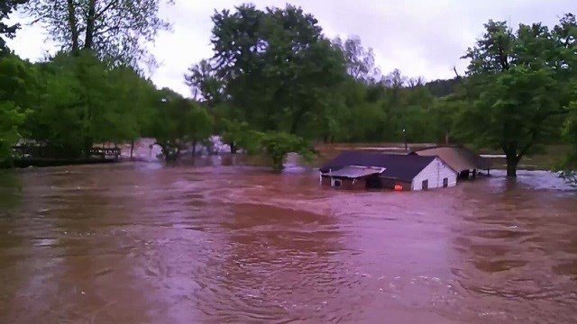 Cabins swept away by flood waters in Desoto, Mo. (Credit: KMOV)