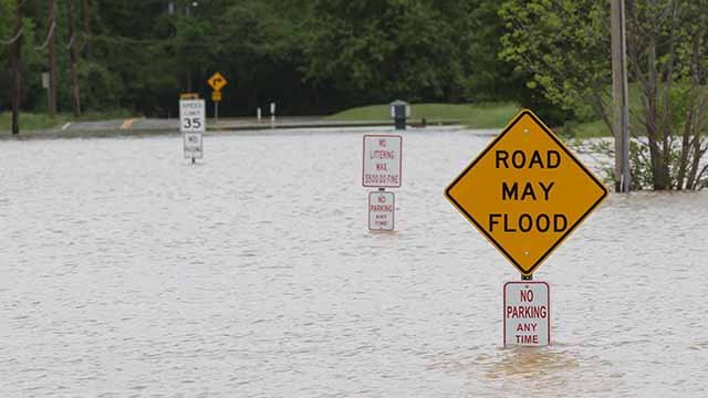 Low-lying  roads are covered in flood water in Sunset Hills, Missouri on May 1, 2017. Flood waters from rivers across the state of Missouri are forcing officials to close roads and people to move.  So far 350 roads have closed.  Bill Greenblatt/UPI