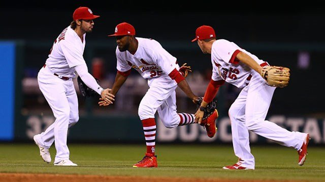 Randal Grichuk #15, Dexter Fowler #25 and Stephen Piscotty #55 of the St. Louis Cardinals celebrate after beating the Milwaukee Brewers at Busch Stadium on May 2, 2017 in St. Louis, Missouri. (Photo by Dilip Vishwanat/Getty Images)