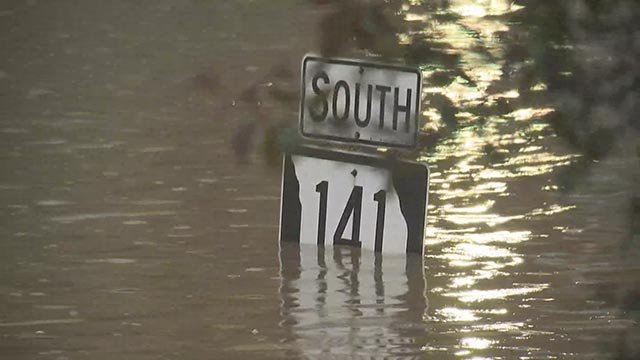 Sign for Highway 141 in Valley Park impacted by floodwaters Wednesday (Credit: KMOV)