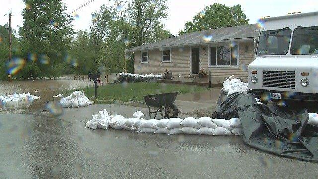 Homeowners in Arnold are not watching to water recede and getting cleanup efforts underway. (Credit: KMOV)